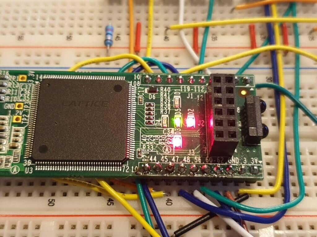 Lattice iCEStick on breadboard with debug LEDs lit